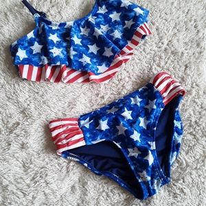 Justice size 8 red white and blue swim suit